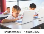 schoolkids using laptop in... | Shutterstock . vector #455062522
