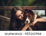 Beautiful Girl Hugging A Dog I...