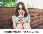 surprised young woman using... | Shutterstock . vector #455212846