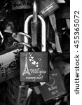 Small photo of PARIS, FRANCE - JUNE 21, 2014: Will you marry me question, Eiffel tower and hearts carving on love lock attached to bridge. Ritual of affixing padlocks to bridge is spread in Europe from 2000s.