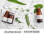 dropper bottles and herbs on... | Shutterstock . vector #455493085