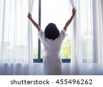 woman  wake up and open the... | Shutterstock . vector #455496262