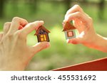 toy ceramic houses in hand   | Shutterstock . vector #455531692