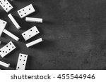 Heap Of Dominoes On Grey...