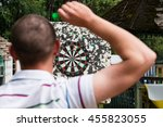 man playing a game of darts ... | Shutterstock . vector #455823055
