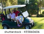 couple in buggy cart on golf... | Shutterstock . vector #455860606
