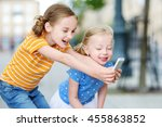 two cute little sisters playing ... | Shutterstock . vector #455863852