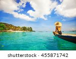 back view of a woman sailing a... | Shutterstock . vector #455871742