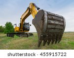 Big Yellow Excavator In Green...