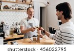 with credit card. cheerful and... | Shutterstock . vector #456022795