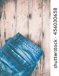 blue jeans on wooden grunge  | Shutterstock . vector #456030658
