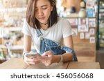 cute asian girl listening by... | Shutterstock . vector #456056068