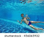 boy diving into a swimming pool | Shutterstock . vector #456065932