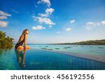 woman sitting on the edge of... | Shutterstock . vector #456192556