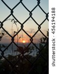 sunset through chain link | Shutterstock . vector #456194188