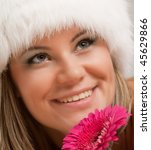 girl in fluffy white cap with flower portrait - stock photo