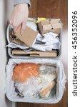 hand puts cardboard in home... | Shutterstock . vector #456352096