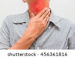 Small photo of Man with sore neck , tonsils,Tonsillitis