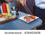 male cook serve delicious steak ... | Shutterstock . vector #456403408