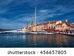 Sailboats And Yachts Moored To...