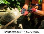 hands wear glove holding rope.... | Shutterstock . vector #456797002