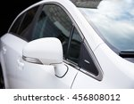 Stock photo close up of white car rear view mirror 456808012