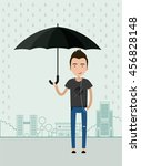 young man  with an umbrella in... | Shutterstock .eps vector #456828148