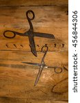 Small photo of Antique old style retro object assemblage on a wooden wall scissors.