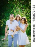 young beautiful family of three ... | Shutterstock . vector #456871438