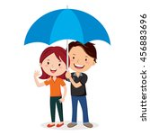 cheerful couple with umbrella.... | Shutterstock .eps vector #456883696