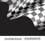 checkered flag flying on black... | Shutterstock .eps vector #456904945