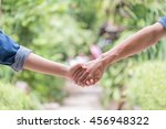couples holding hands | Shutterstock . vector #456948322
