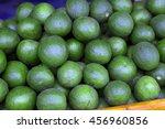 Bunch Of Green Avocados. One O...