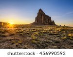 Sunset above Shiprock. Shiprock is a great volcanic rock mountain rising high above the high-desert plain of the Navajo Nation in New Mexico, USA