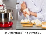 chef pastry cream filling some... | Shutterstock . vector #456995512