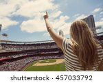 woman standing and cheering at... | Shutterstock . vector #457033792