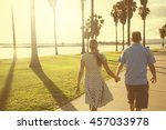 middle aged couple walking... | Shutterstock . vector #457033978