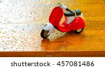 Mini Motorbike On Wooden Floor.