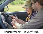 cheerful young tourists using... | Shutterstock . vector #457094308