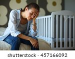 young tired woman sitting on... | Shutterstock . vector #457166092
