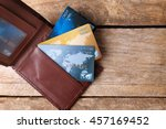 Stock photo credit cards in leather wallet on wooden background 457169452