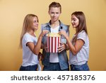 three young people with popcorn | Shutterstock . vector #457185376