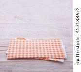 paper napkin on old wooden...   Shutterstock . vector #457188652