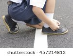 Child Student  Tying Shoes At...