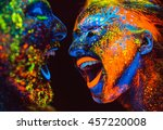 Stock photo portrait of a pair of lovers painted in fluorescent powder 457220008