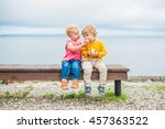 Toddlers Boy And Girl Sitting...