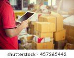 a man using tablet checking the ... | Shutterstock . vector #457365442