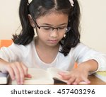 Small photo of School student kid reading book in classroom or library for education concept and national library lover week campaign