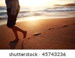 A Girl Walking On A Beach In...