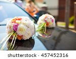 white bouquets lie over black... | Shutterstock . vector #457452316